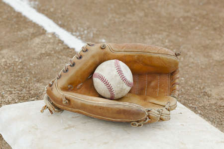A baseball glove in a baseball diamond Stock Photo - 9737413