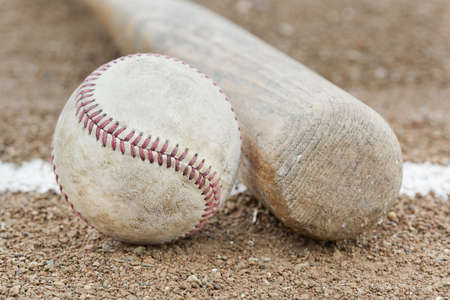 A baseball and a baseball bat photo