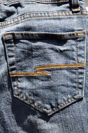 fabric texture: A pair of denim jeans