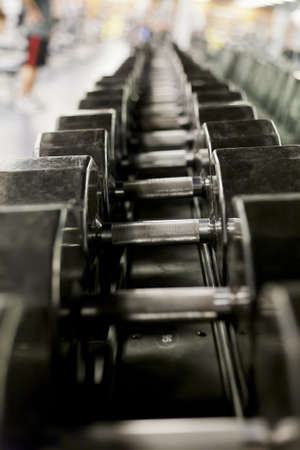 man lifting weights: Weights in a gym
