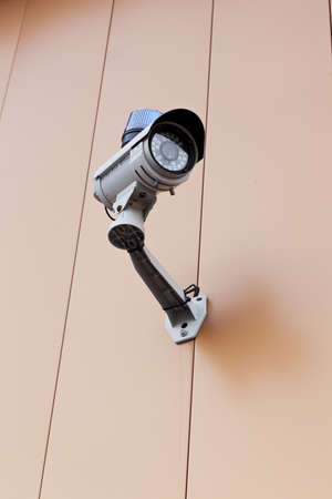 A security camera on a wall