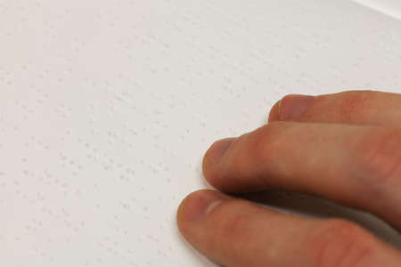 A hand on a braille book Stock Photo - 9736009