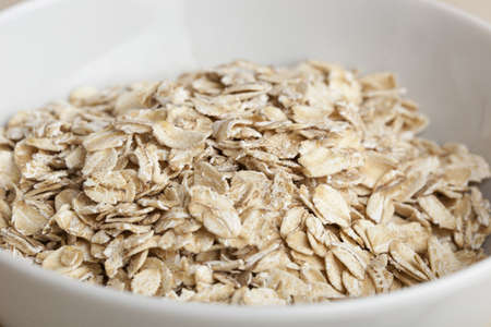 Dry Oatmeal in a bowl photo