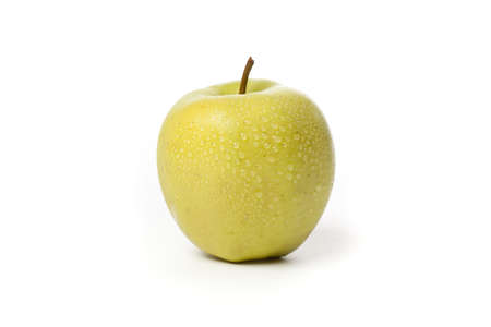 golden: A fresh golden delicious apple on a white background Stock Photo