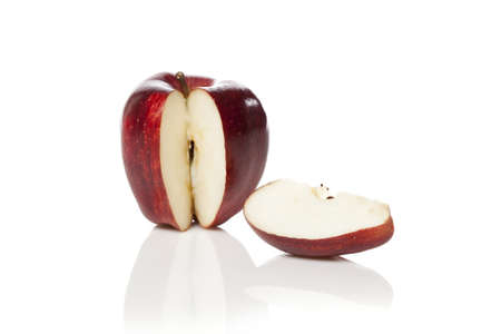 A fresh red apple with a slice cut out on a white background Stock Photo