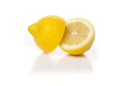 A fresh yellow lemon that is cut photo