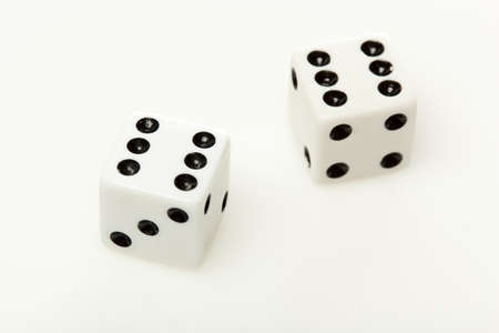 White dice with black dots against a white background Stock Photo - 9776255