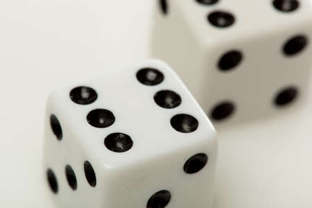 White dice with black dots against a white background Stock Photo - 9776435
