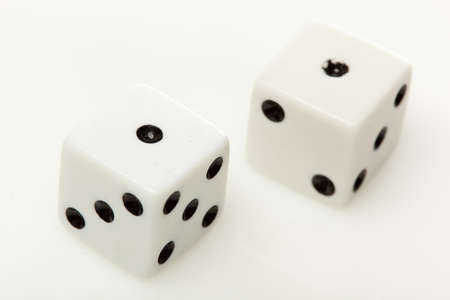 White dice with black dots against a white background Stock Photo - 9776382