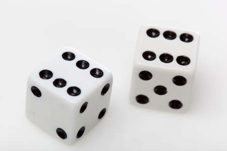 White dice with black dots against a white background Stock Photo - 9776388