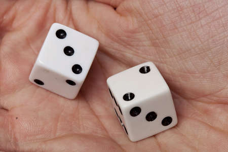 White dice with black dots in a persons hand Stock Photo - 9776507