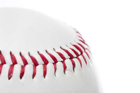 A clean white baseball against a white background photo
