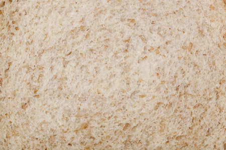 A piece of whole wheat bread texture closeup photo
