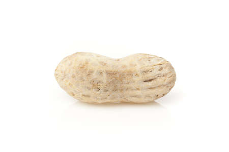 Shelled Brown Peanuts against a white background Stock Photo