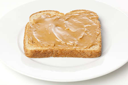 peanut butter: A peanut butter sandwhich against a white background Stock Photo