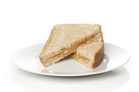wheat toast: A peanut butter sandwhich against a white background Stock Photo