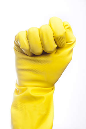 A yellow cleaning glove against a white background photo