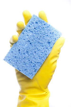 A yellow cleaning glove with a sponge against a white background photo