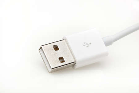 A white USB cable against a white background photo