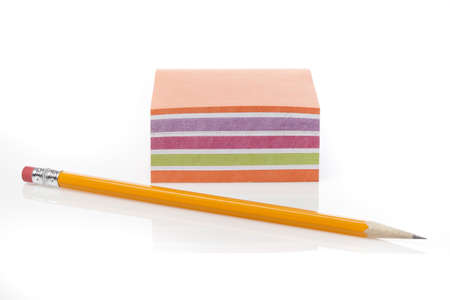 A colorful note pad with a pencil against a white background Stock Photo - 9864776