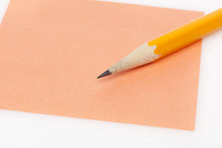 A colorful note pad with a pencil against a white background Stock Photo - 9864788