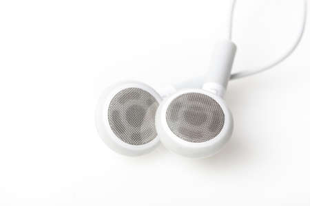 earbud: White ear buds against a white background