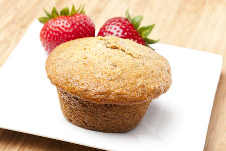 bran: A fresh bran muffin against a white background