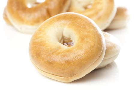 A fresh plain bagel against a white background Stock Photo - 9990409