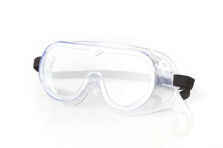 Clear safety glasses against a white background Foto de archivo