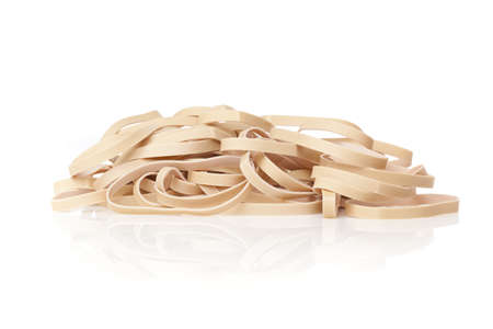 A tan rubber band against a white background Stock Photo