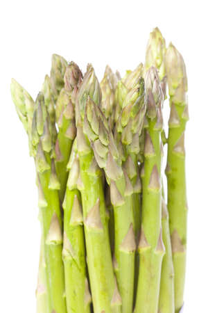 Fresh green asparagus against a white background photo