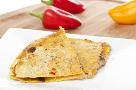 A cheese quesadilla  against a white background photo