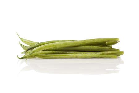 A fresh green string bean against a white background photo