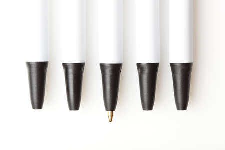 A black and white ballpoint pen against a white background photo