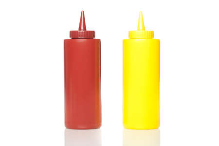 A mustard and ketchup bottle against a white background photo