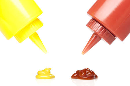 A mustard and ketchup bottle against a white background