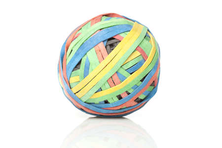 elastic band: A colorful rubber band ball against a white background