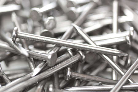pounding head: Silver Steel nails made for construction Stock Photo