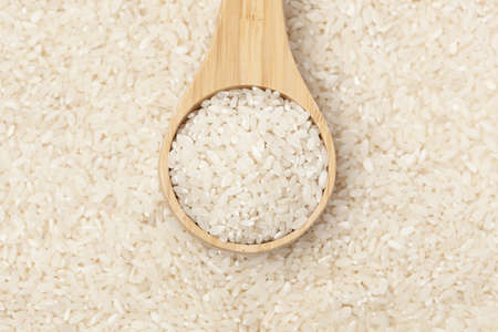 A heap of Healthy Dry Brown Rice ready to cook Stock Photo - 13965112