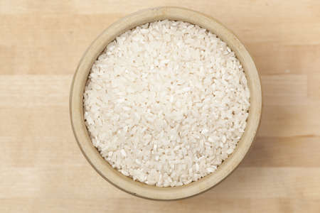 A heap of Healthy Dry Brown Rice ready to cook Stock Photo - 13972814