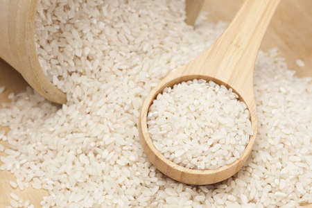 A heap of Healthy Dry Brown Rice ready to cook Stock Photo - 13972818