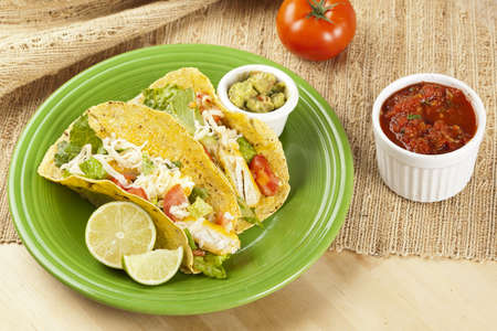 Homemade fresh fish tacos on a green plate photo