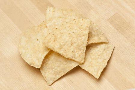 corn tortilla: Fresh Corn Tortilla Chips on a wooden background Stock Photo