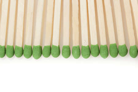 Green Wooden Matches against a back ground photo