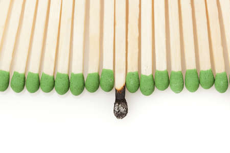 Green Wooden Matches against a back ground