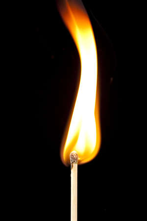 Green Wooden Matches on fire against black photo