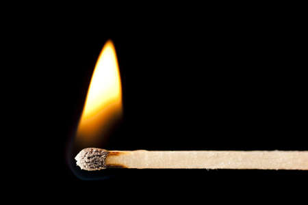 matchstick: Green Wooden Matches on fire against black