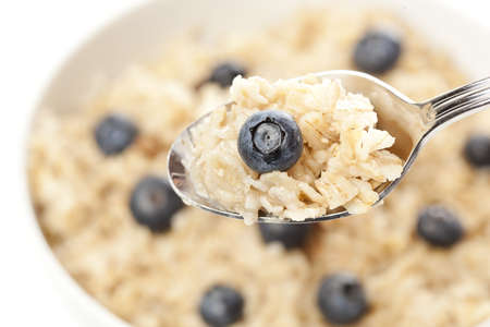 Organic Cooked oatmeal with blueberries for breakfast