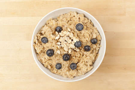 Organic Cooked oatmeal with blueberries for breakfast photo