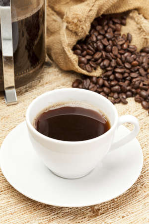 Black Coffee with coffee beans on a background photo